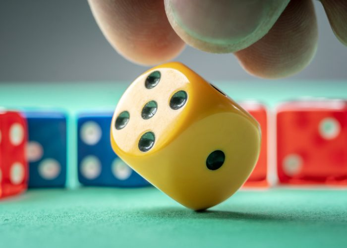 hand-is-throwing-yellow-dice-green-table-concept-casino-lucky-chance-win